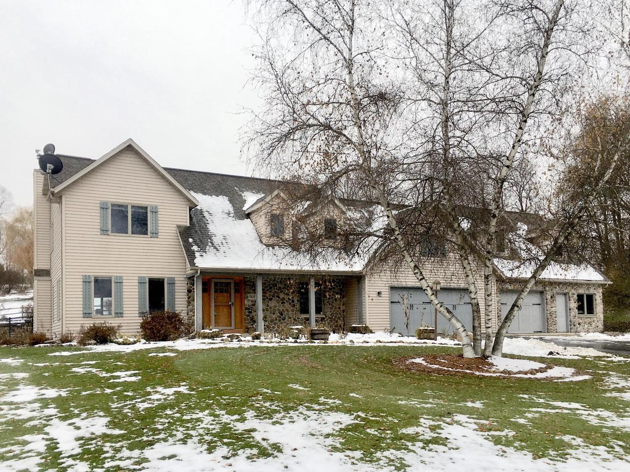 View Single-Family Home For Sale at 7627 Pond View Ln, West Bend, WI