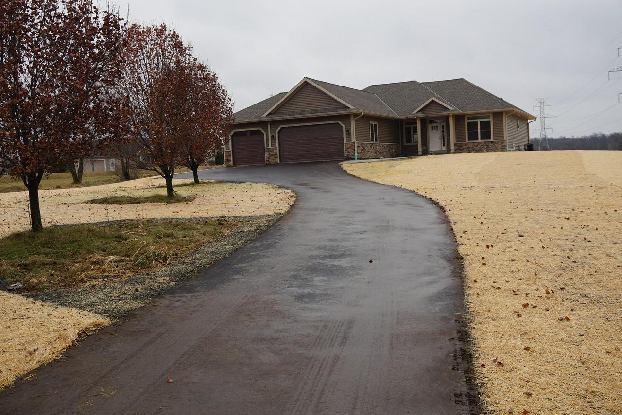 View Single-Family Home For Sale at 21647 8 Mile W Rd, Muskego, WI