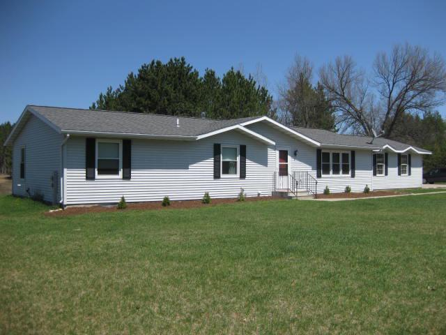 View Single-Family Home For Sale at W10066 Barnes Lake Rd, Dunbar, WI