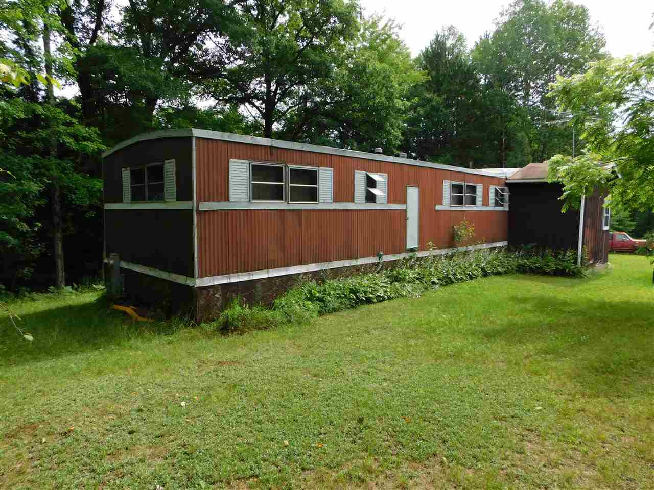 View Single-Family Home For Sale at 12390 RIVER BEND LANE, Suring, WI