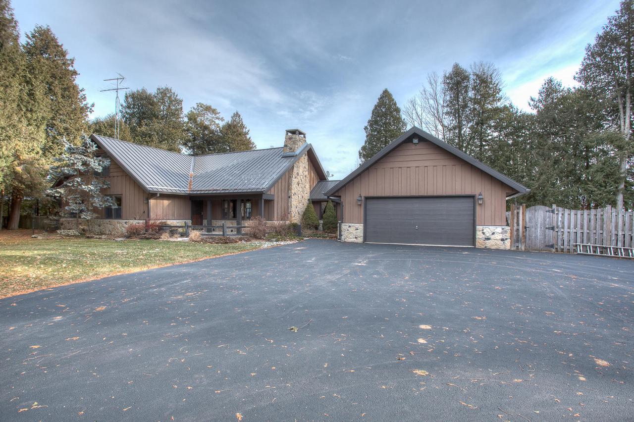 View Single-Family Home For Sale at N6712 N Harbor Pt Lane, INGALLSTON, MI