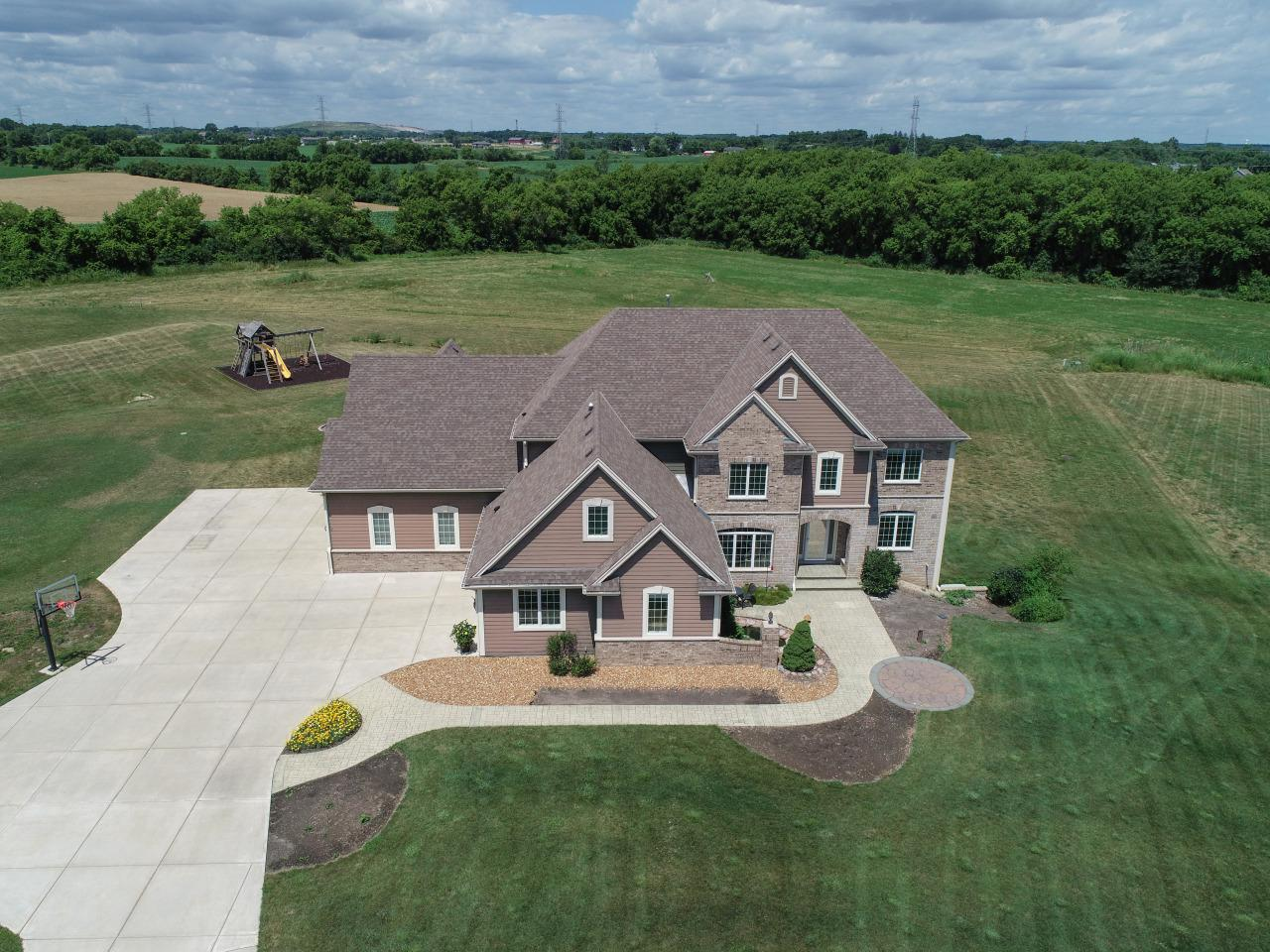 View Single-Family Home For Sale at 8224 W Stone Creek Cir, Caledonia, WI