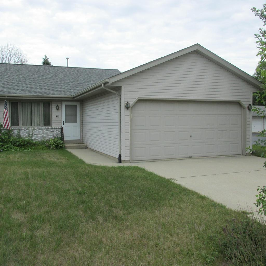 Ranch style side by side condo with no Condo FEE!!! 2 bedroom, bath, and laundry room all on the 1st floor.Master bedroom with 2 closets. Nice size living which opens to eat in kitchen. Lower level rec room which is plumbed for bathroom. Roof was replaced in 2014.