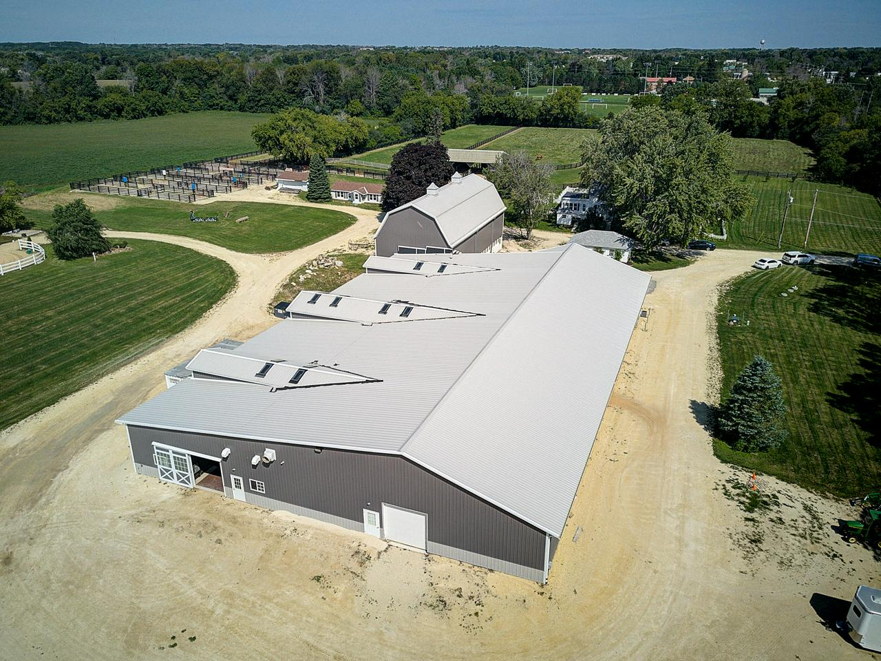 This well-appointed, 28 +/- acre horse farm is the perfect place to realize your equestrian dreams. Surrounded by farmland yet close to amenities, it was completely renovated in 2016. Horse enthusiasts will appreciate the equestrian spa and 16 custom, 16x12 stalls, each with video monitor. The main barn has in-floor heat and includes wash stall, tack lockers & lounge with kitchen, fireplace and powder rooms. A second barn can be converted for stalls or boarding. The heated 60x150 indoor arena ensures comfort. The 200x300 outdoor arena is perfectly situated for beautiful views while training. The Kentucky board pastures and dry lots with automatic waterers make horse care easy. Two homes on the property provide a rental option. This is one property you need to experience to believe!