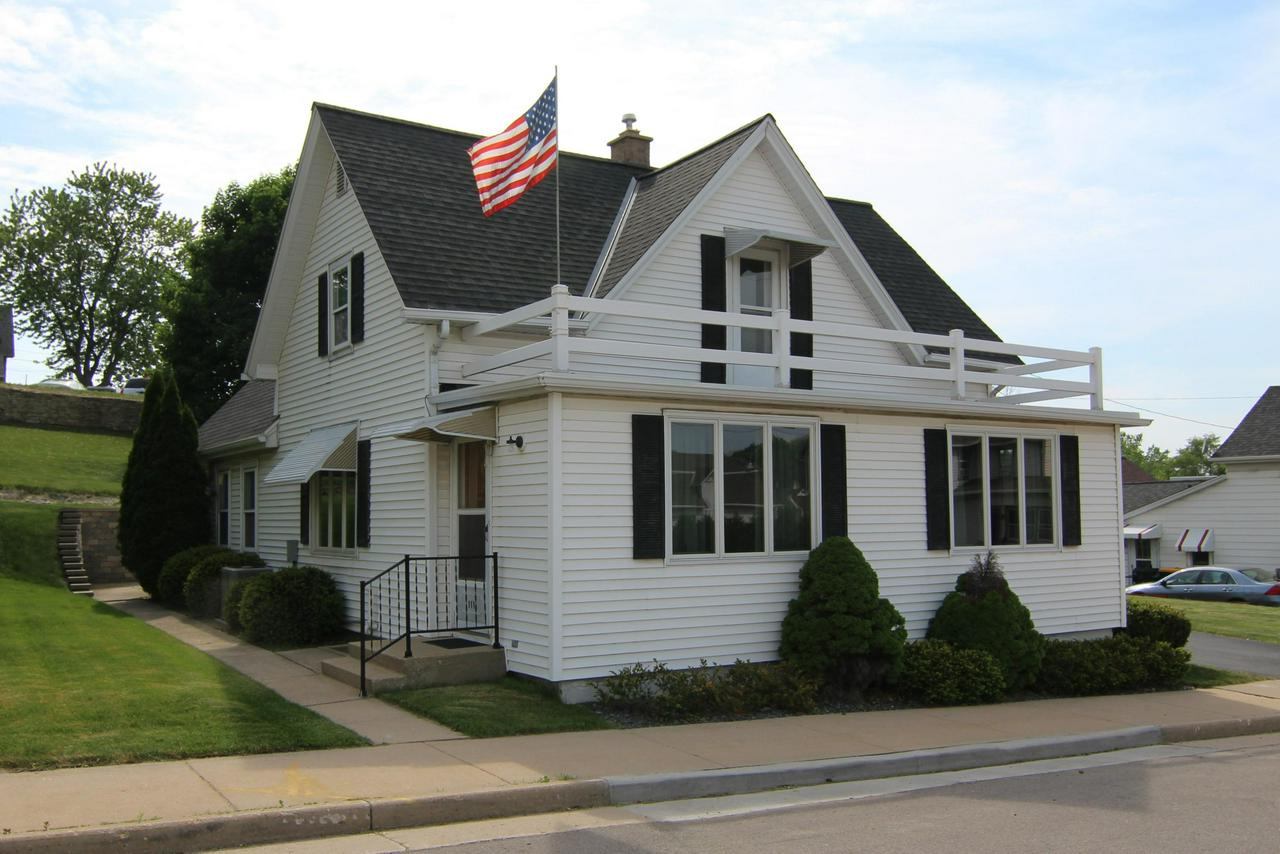 1ST TIME OPEN ~ SUN, SEPT 9 ~ NOON to 1:30 PM!  Well maintained & lovingly cared-for 3 BR home in the Village of Slinger. Conveniently located within walking distance to Slinger Schools & parks! Many updates include roof in 2014, furnace & central A/C unit in 2010, beautiful retaining wall by back patio, electrical, siding, some Andersen casement windows & more! Large eat-in kitchen w/ refaced cabinetry. Wonderful floor plan w/ spacious Living Room/Family Room combo. Newer Andersen custom-sized large windows in Living Rm/Family Rm. Large detached 2.5+ garage w/attic storage above. Move-in ready!