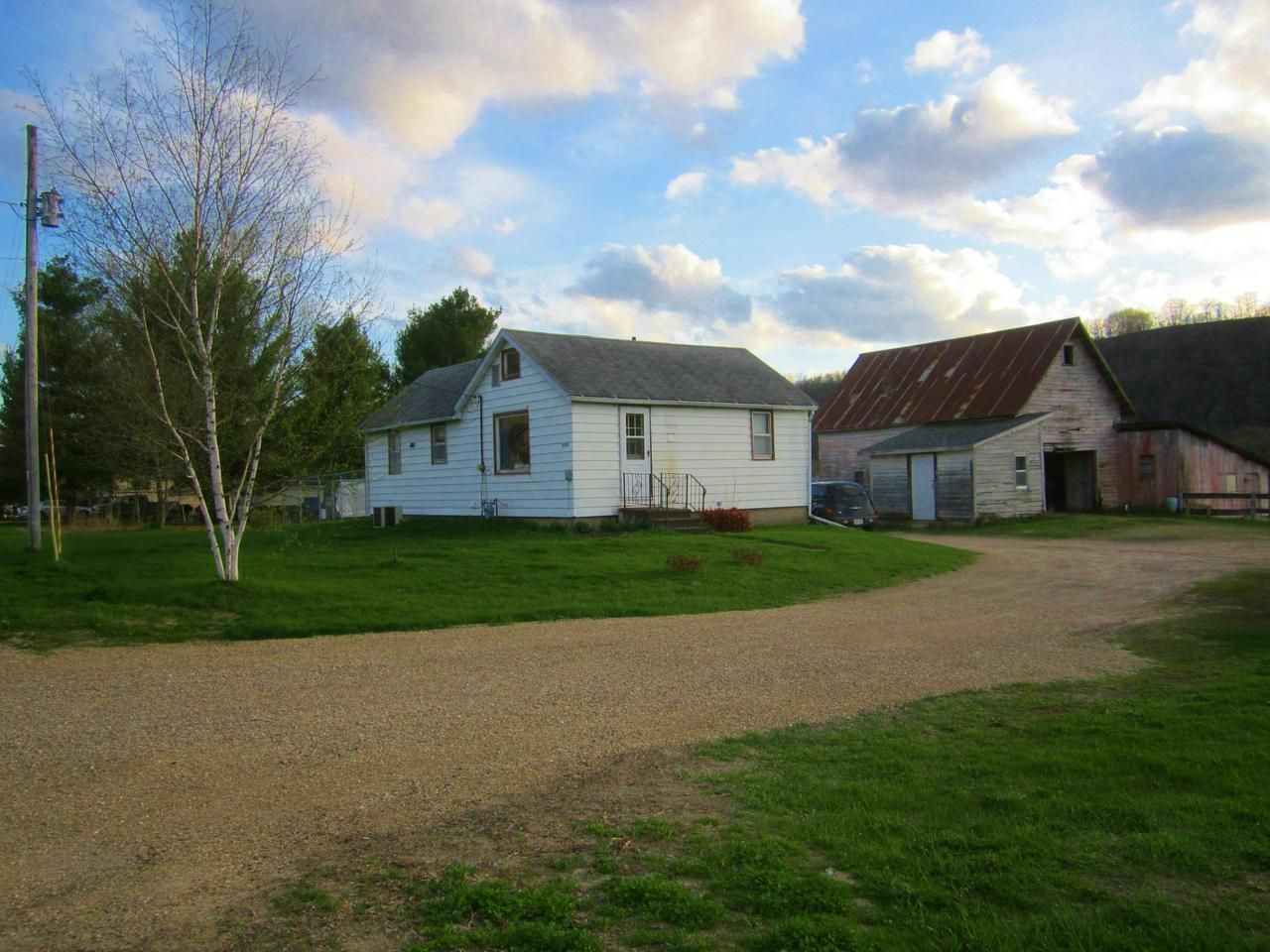 Hobby farm with frontage on the Kickapoo River.  Includes acreage that could be used for crops, a vegetable farm, cattle operation, or horses.  Enjoy fishing, swimming, canoeing, or camping by the river.  Additional acreage available.