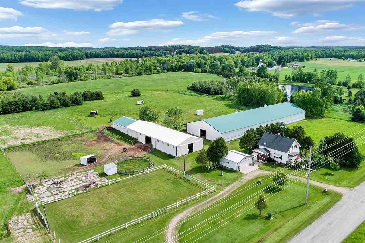 10 Acre Farmette is the perfect setting to raise, train & board horses! 66x200 indoor riding arena, 60x100 outdoor arena, 6 fenced pastures w/5 pasture shelters, tack room, wash stall, removable stall dividers for foaling & a breeding/foaling area. There are 2- 2.5 car detached garages Plus Fruit trees & perennial gardens. The 1.5 story country farm house offers hardwood floors, eat-in kitchen & updates that include newer water heater, softener, interior & exterior paint, remodeled bath & newer roof. Ready for your own personal touch. Seller is offering a 1 year Home Warranty with Sale!