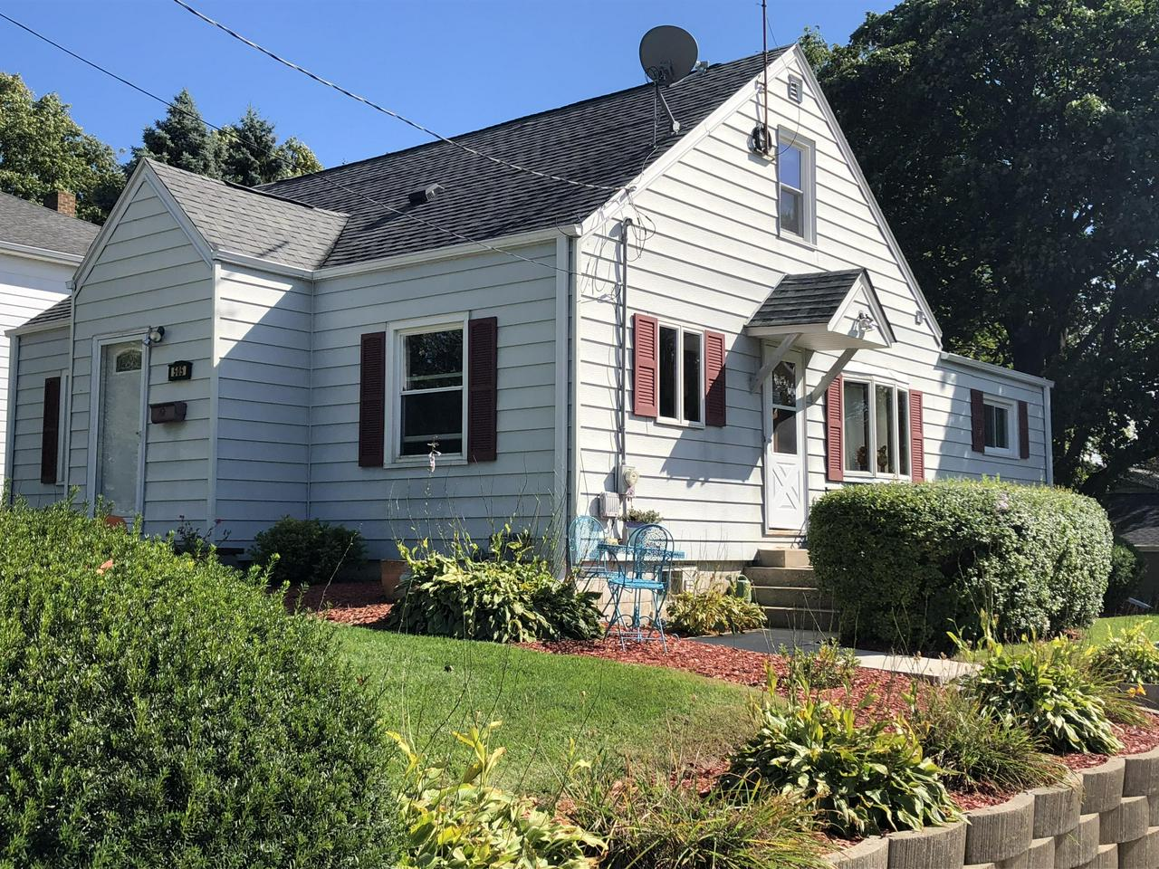 Fall in love with the charm of this 3 Bdrm, 1 BA Cape Cod! Situated on a corner lot in Hartford. 2.5 detached garage (new roof, siding, door in 2010. Kitchen features custom built cabinets (2014), new countertops (2014). Beautiful hardwood floors in the kitchen and dining room. Entertain guests in the formal dining room or rec room in the lower level. Newer carpet in living room, rec room and bedrooms on the first floor. New windows in 2010.  All appliances included. Close to schools and parks!