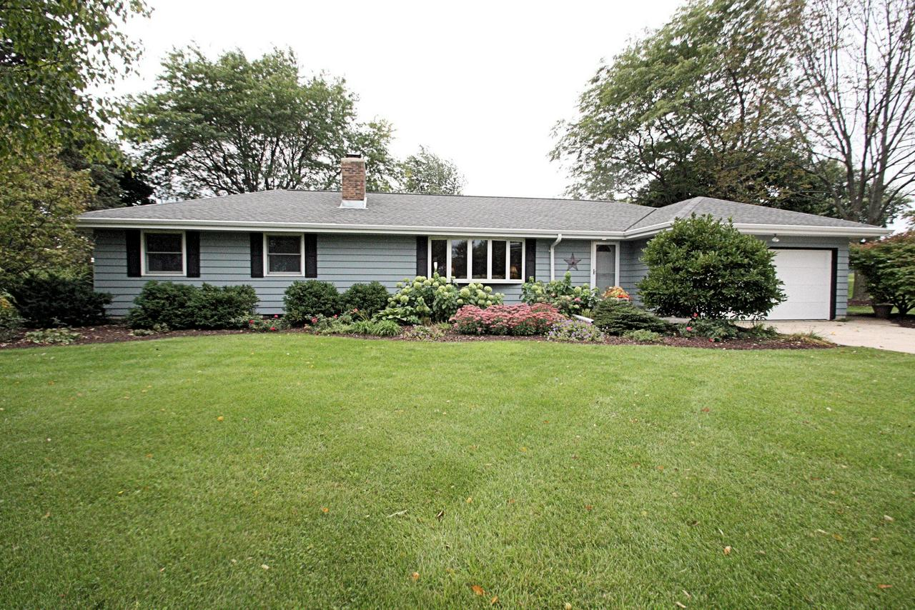 Carefully maintained, private Grafton 3 Bedroom 1.5 Bath Ranch.  Large foyer opens to sunlit living room with bow window, natural fireplace and newer carpet.  Updated kitchen has oak cabinets, newer counters, newer sink and faucet,  walk in pantry, updated appliances and hardwood floors.  Dinette features bow window & BICC.  Private family room just off the kitchen.  Updated bathrooms with tile floor and solid surface counters.  Full wall of closets in Master.  Lower level rec room plus game area & wood stove is the perfect children's play area or man cave.  Gorgeously landscaped yard with pretty deck, fire pit area and storage shed.  Low town taxes.  3 yr tear off roof, new well pressure tank. Super location--convenient to Costco, Meiers, Home Depot & Hwy 43 access.
