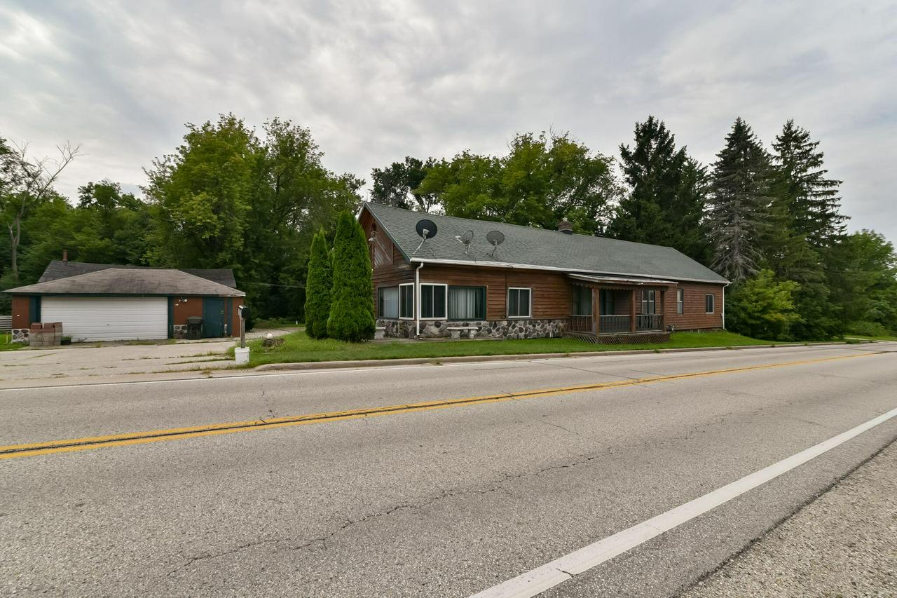 Don't miss out on the opportunity to buy this Unique 3 Bedroom, 1.5 Bath, 3 Car Detached Garage in the Town of Erin. Home features large kitchen with lots of cabinet space. Dining room off  of kitchen is large enough for entire family. Huge living room with stone natural/gas fireplace to enjoy. Easy commute to Milwaukee as 41/45 is about 5 miles away. Large 1 acre yard for your enjoyment. Located in the foothills of Holy Hill with Heilger Huegel Ski Club views. Bring a little sweat equity to make  this place yours.