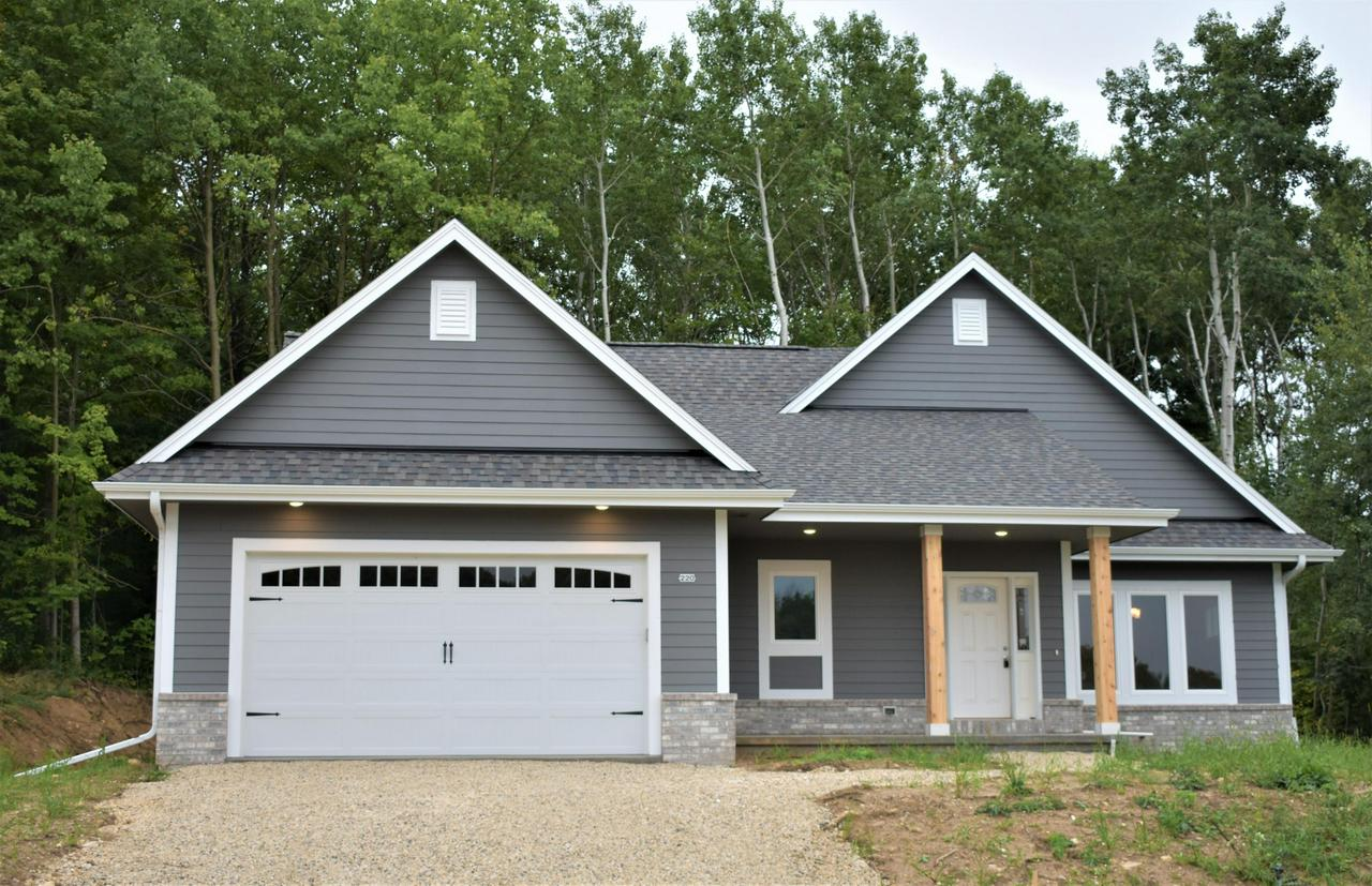 Set in a quiet neighborhood, this new construction is ready for its first family! This elegant home has three-bedrooms, two full baths, a huge basement, and a fire place with views of the wooded backyard. Built by Grand GENEration Homes, this home features the highest quality of materials. Located in the Slinger School District, close to Pike Lake State Park and shopping, with easy access to Highway 60, I41/I45.