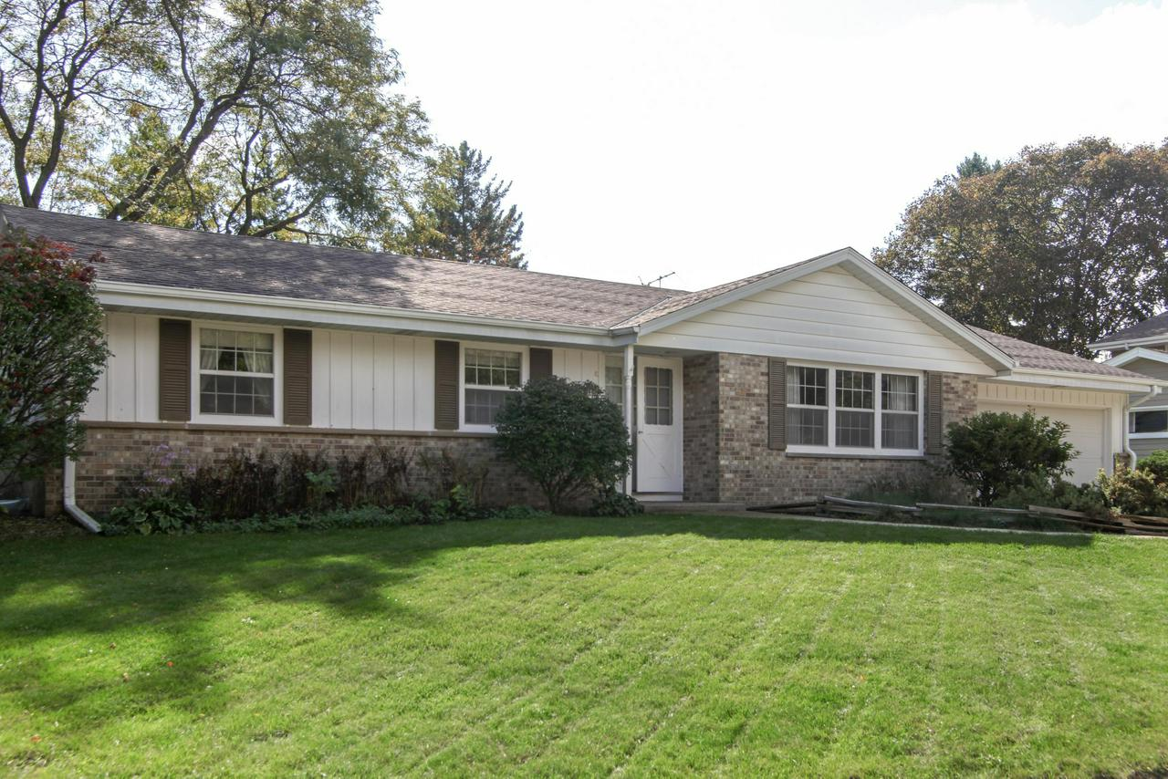 Prime Cedarburg location & fantastic backyard is the setting for this Maple Manor ranch.  Big living-dining room combination has room for all the family to gather.  Family room offers wood burning brick fireplace.  Sunny eat-in kitchen has ample counter and cabinet space.  Spacious bedrooms all with hardwood flooring under carpeting.  Master bedroom has dual access to hallway bath.  There's also a second full bath on main floor.  Big unfinished lower level has higher ceiling and plenty of room to expand.  Great patio area to enjoy your big, beautiful yard.  Just one block to All Children's Playground, park & pool.  Walk to schools & downtown Cedarburg too.  1 year home warranty offered to buyer.