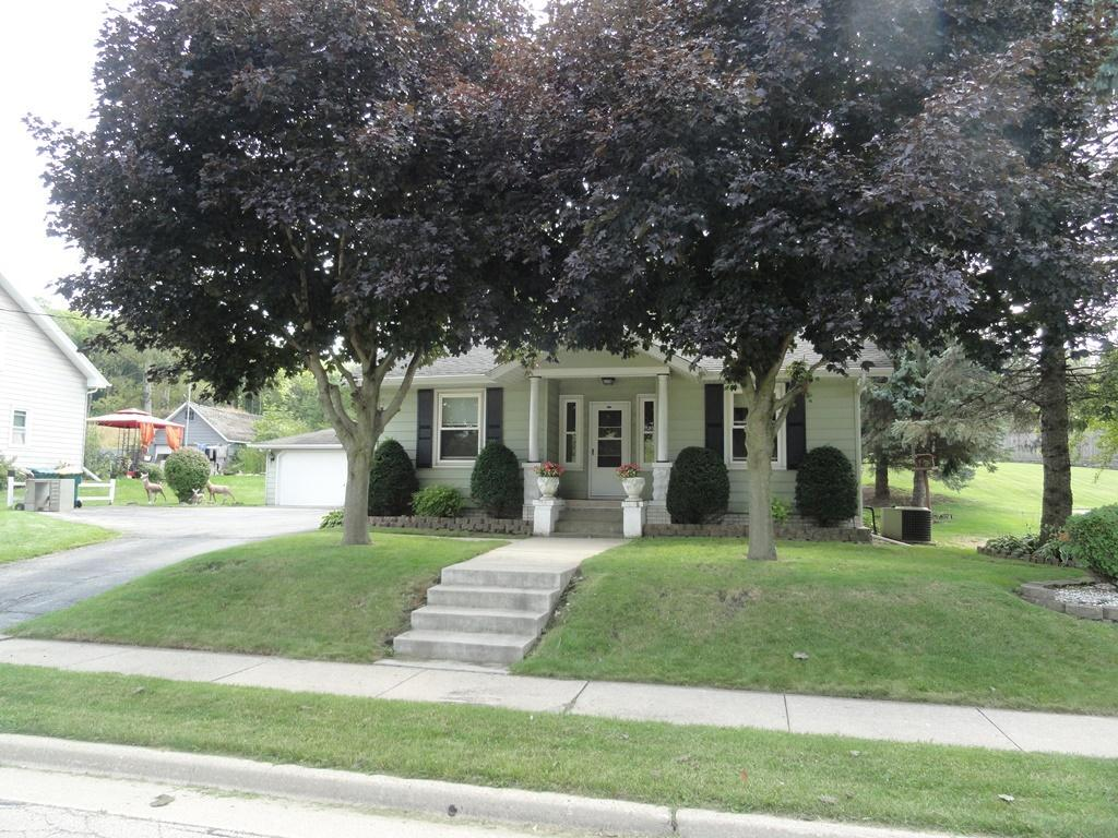 Affordable home in Slinger Schools district and close to downtown.  Very charming throughout. Enjoy meals in the formal dining room. Nice features include wood floors, huge private back yard, central air and extra large 2.5 car garage. Call today for your private showing