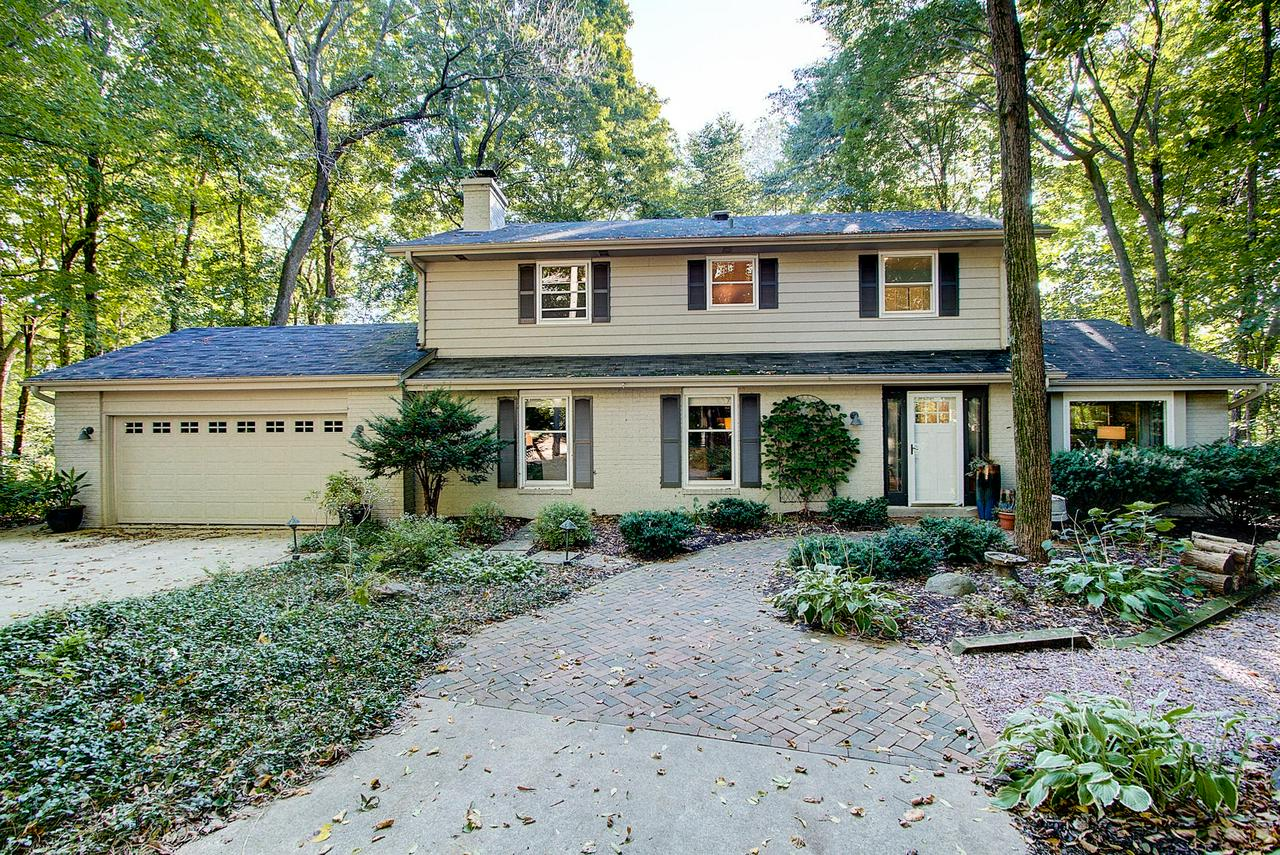 Loaded with charm, this beautiful Colonial is perfectly nestled on a private wooded lot on Cedar Creek!  Stylish Hardwood floors throughout main level with custom built in's in living and family rooms. Completely updated kitchen with SS appliances, center island and eat-in area opens to multi-level deck. Entertain and enjoy the outdoor living space surrounded by gorgeous wooded landscape and creek views.  With 4 bedrooms, 3 full baths and lower level rec room with egress windows this home offers all the right spaces and a welcoming cozy feel. Don't miss this opportunity for complete tranquility just minutes away from downtown Cedarburg. Come see this lovely home today!