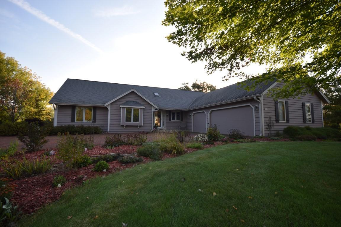 Come see this 3 BR, 2 BA open concept ranch home with 3.5 car attached garage on a private 1.5 acre lot in the town of Richfield in Slinger School District.  Features include vaulted wood ceilings, granite countertops in kitchen with breakfast bar, stone fireplace, large bedrooms and huge master with walk in shower and separate jetted tub.  2nd full bath with large skylight.  1st floor laundry. Huge deck in the back to enjoy the great views from your private backyard.  Call today!
