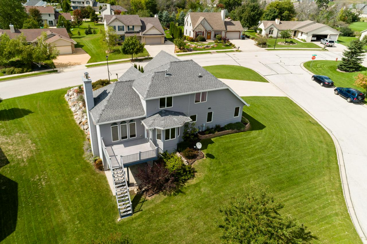 You will be impressed from the minute you enter this stately & exceptional Open Concept Style gem boasting 4br+/3.5ba, with full walk out lower plus 3.5 car garage, insulated & with pull down stairs. The Towering foyer is breathtaking offering Italian Tile & gorgeous lighting. Great Rm w/Fieldstone NFP, 10' ceiling, HWF. Kitchen w/Island/Snack bar combo,HWF, Dining area features patio doors to spacious composite deck great for entertaining or just relaxing! Grand Master Bedroom w/WIC & beautiful full bath. Finished Recreation Room in Lower level w/walkout, 9' ceilings, full bath, Den/Office plus 4th Bedroom. Additional features include, 1st floor laundry, underground dog fence, Central Vac, Lush Landscaping, and super location! Truly a Gem!