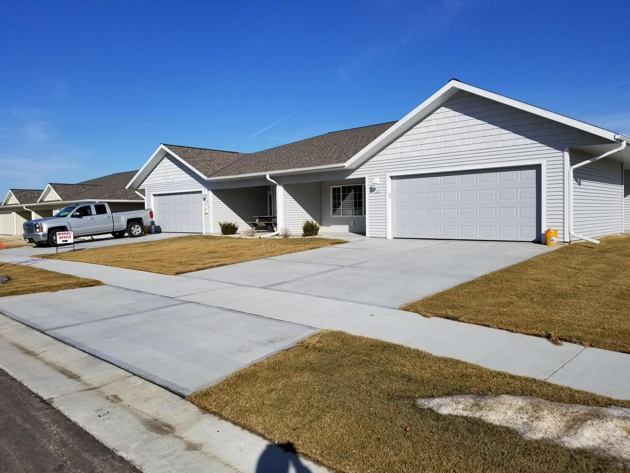 New construction for 2018.  1st floor senior ranch ready to move in Fall of 2018.  3BR, 2Ba, 2 car garage, utility/storage room, snack bar, pantry, 1,700 sq ft.  No step at front, back and garage.  Walk in closets, 3' wide doors.  Front covered sitting porch.  Choose countertops, lights, flooring.  Clubhouse - Hall with Den/Library/Game Room/Patio.  Landscaping/Walks/Drives included.  City Sewer/Water/Streets/Sidewalks.  Low $105/mo fee.  Adjacent City Wooded park.  Garden area each unit.  Walk to shop/eat/bank/medical.  Sold Out!