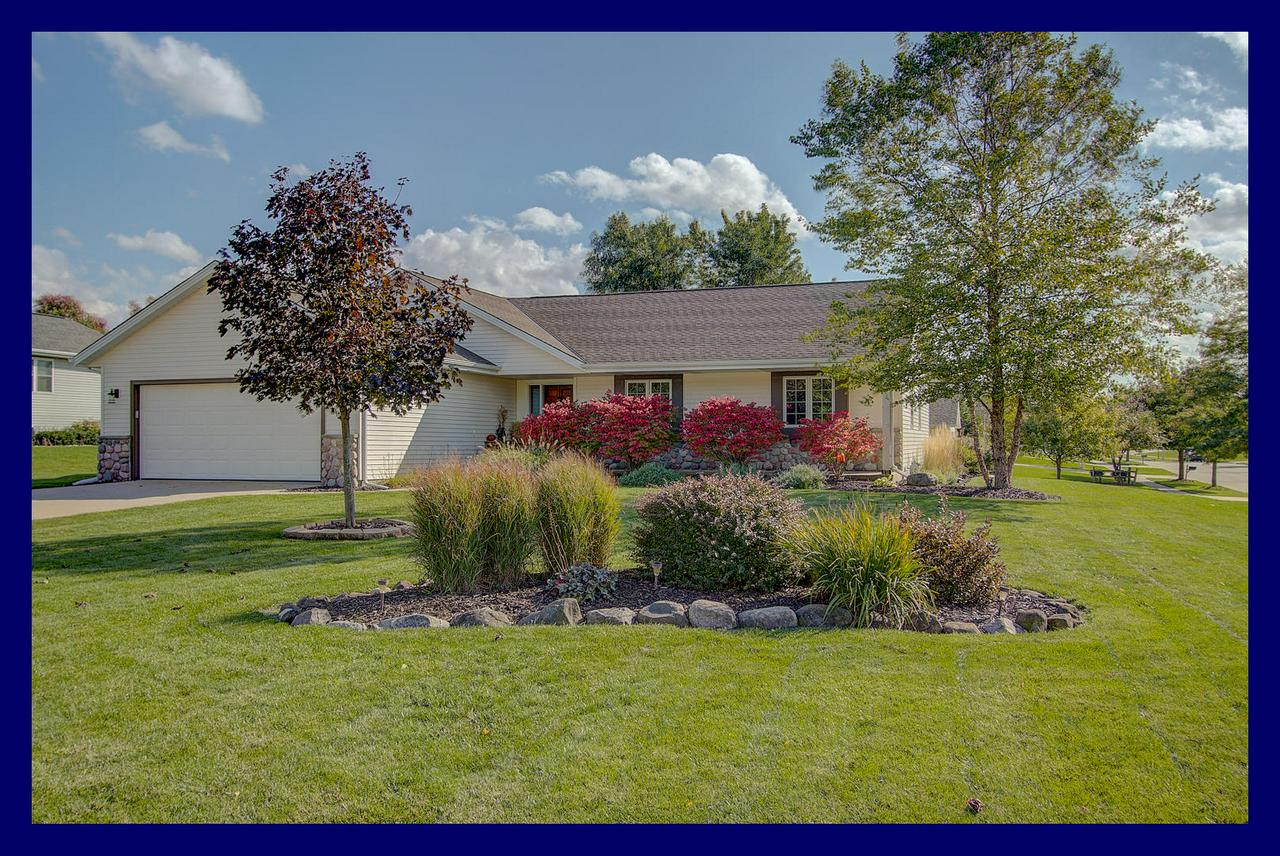 Wonderfully maintained and updated ranch in friendly neighborhood within walking distance to Slinger middle school. LR is warmed by raised-hearth stacked stone NFP. Updated kitchen features an abundance of cabinets and granite counters, BB, wood floors & incl appliances. MBR suite features large bath w ceramic tile floor, granite vanity, whirlpool tub & SS. Finished lower level adds considerable living space incl FR big enough for Packer/Brewer parties or kid's hangout space, snack/game table area, exercise/flex room and plenty of storage. Outside you'll find a large, private patio area, expansive front porch and beautiful landscaping. Roof 4 yrs, furnace 2 yrs, HWH 3 yrs.  Conveniently located just minutes to HWY 41, grocery store, Little Switzerland ski hill and Pike Lake State Park .