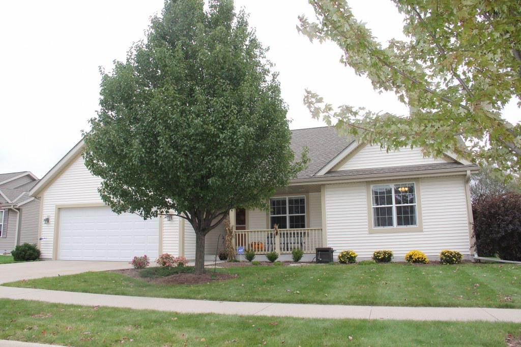 Quality built WI energy certified Ranch by Hammond Bldrs. Vaulted ceilings in open concept KIT/DR/Great Rm. Large KIT w/newer counter tops & sink boasts some soft close drawers & window over sink overlooking mature backyard landscaping. Newer laminate gray HWFs thru KIT/DR/main flr laundry, foyer. Appliances Incl. Dining area w/patio door to flat backyard & approx. 13x16 concrete patio. Great rm has gas FP w/blower & is flanked by long windows on each side allowing morning Eastern sun to light up the room w/natural light. 6 panel drs thruout. MBR suite w/His & Her closets, window seat & large window overlooking private backyard. Master BA w/SS & ample storage. Finished LL has canned lighting, finished rec space & 3rd full BA w/solid surface vanity top, tile floor & SS w/gorgeous tile work.