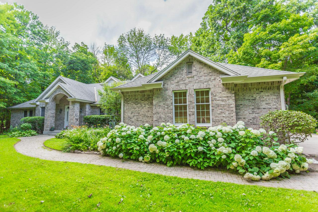 Opportunity Knocks! At $100,000 Below Assessed Value, You Can Have A New Home for the Holidays! 6,000 sq ft executive ranch w/stunning views from every angle. Walkout LL, screened in porch, & huge wrap around deck allow wonderful access to 1.64 acre private, wooded lot. 5 BRs most w/WIC, 4 BA (2 en suite/2 w/whirpool tubs), 3.5 Heated GA, Dedicated Office, FDR, Eat-in Gourmet KIT w/ range top/grill & prep sink, 2 laundry rooms, FR w/floor to ceiling Montana stone NFP & HWFs, 6 panel doors throughout. Versatile finished LL suited for In-Law/Guest Suite, Business, & Hobbies. Disability friendly. Whole house generator & radon mitigation system. One has to see this home to truly & fully appreciate the luxury & space it offers! See extensive list of updates in Documents.
