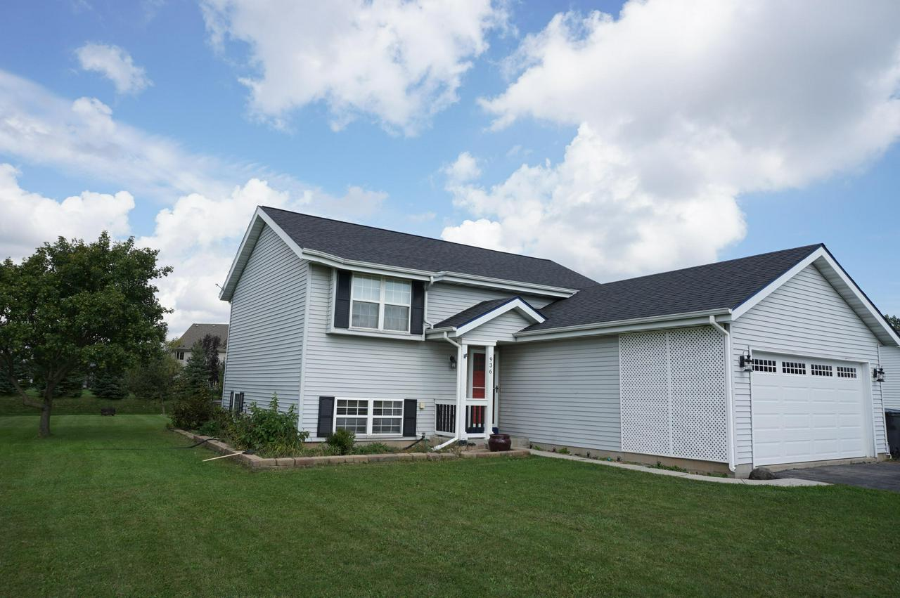 Only an out of state relocation makes this home available for sale.  Spacious 4br/2ba with a generous .315 acre village lot.  Upper level offers  vaulted ceilings, Living Room leading to Kitchen w/patio doors to deck.  Master Bedroom and second bedroom plus updated full bath. Lower level with 2 additional bedrooms, full bathroom and Family Room, Laundry Room and lots of storage. Low maintenance exterior and  a great backyard.