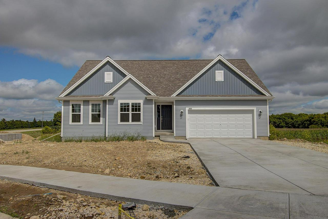 Energy-Efficient NEW Construction built for the way YOU live - Ready August 2018! The Jackson Ranch plan is a 3BR/2BTH in an open concept design. Kitchen offers a corner pantry and sit-at island that is open to the GR and dinette for easy entertaining and gathering. Home highlights include split vanities in the Master BR, fireplace in GR, Look-out LL, and storage space through-out.Concrete Driveway, Seeded Lawn Included!