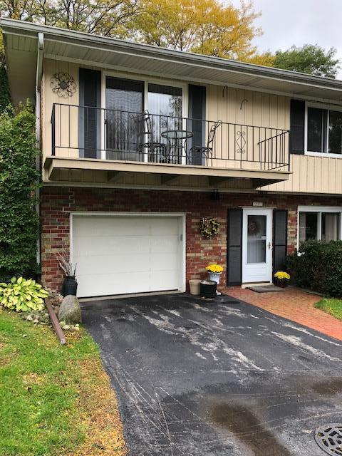 Enjoy this beautiful 2 bedroom Mequon condo with  views of the lake.  Condo located on a corner lot providing sweeping grounds for enjoying the outdoors.  Nicely updated home with vaulted ceiling gas fireplace, beautiful outdoor patio.  Large kitchen with formal dining room and breakfast bar.  Wet bar off the kitchen makes this home great for entertaining.  enjoy private porch off master bedroom.  Loft office and lower den make this your perfect new home.
