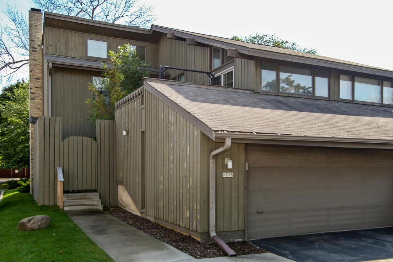 Private corner unit condo offers tremendous value. Spacious and within walking distance to Mequon Pavilion. 2 bedrooms with vaulted ceilings plus den with laminate floors throughout. Newly redone kitchen, cozy great room, 2 fireplaces. Fullbasement, 2 decks plus a nice yard and patio, pool and 2 car attached garage. Double insulated windows replaced 3 years ago. Fresh paint in basement and garage floor.