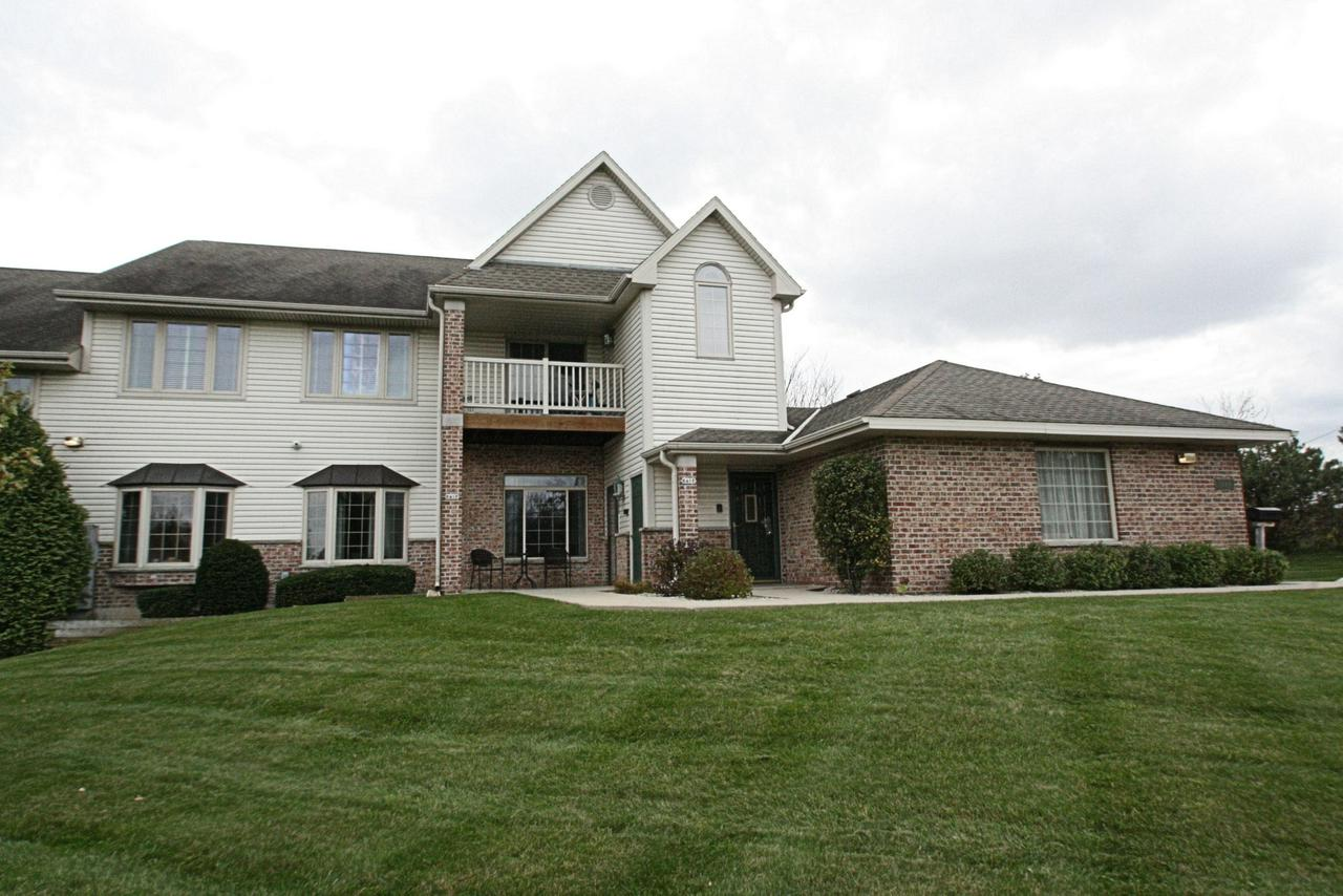 Location, location.  Desirable 2 Bedroom 2 Bath open floor plan 2nd floor condo.   Recently painted in neutral colors, newer window blinds and carpet professionally cleaned.  Great room has vaulted ceiling and gas fireplace with sliding doors to private balcony.  Adjoining den/office.  Opens to kitchen with oak cabinets, breakfast bar, all appliances, pantry and dinette.  Master has large walk-in closet & private bath. Guest bedroom with 2nd full bath. Original owner.  In-unit laundry includes washer & dryer.  New furnace and A/C 2017, updated Water Heater.  Pets welcome--1 cat or dog up to 16'' at shoulder.  Attached 2 car garage.  Just minutes from I-43, shopping, schools and restaurants.