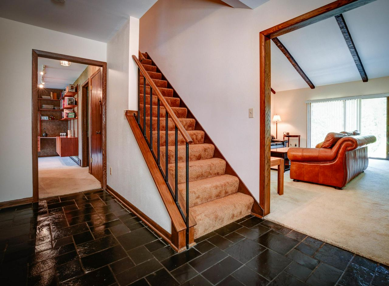 Wow! Huge condo feels like a single family home!  You'll love the clean & bright open floor plan with sun filled rooms. Great room with vaulted ceiling, a formal dining room as well as Eat-in kitchen w recessed lighting & wood floors. HUGE main floor master suite with dressing area & 2 walk-in-closets  Upper level guest bedroom, full bath and loft. 1st floor laundry, loads of closet space plus an attic & a basement for even more storage.  1st floor den (could become 3rd bedroom).  You'll love this pet-friendly community w/ 108 beautiful landscaped acres, fishing, canoeing, tennis and pickle ball. Roof was replaced in 2012! Home Warranty offered for Buyer's peace of mind. Check out the 3D tour under ''Photos'' tab!