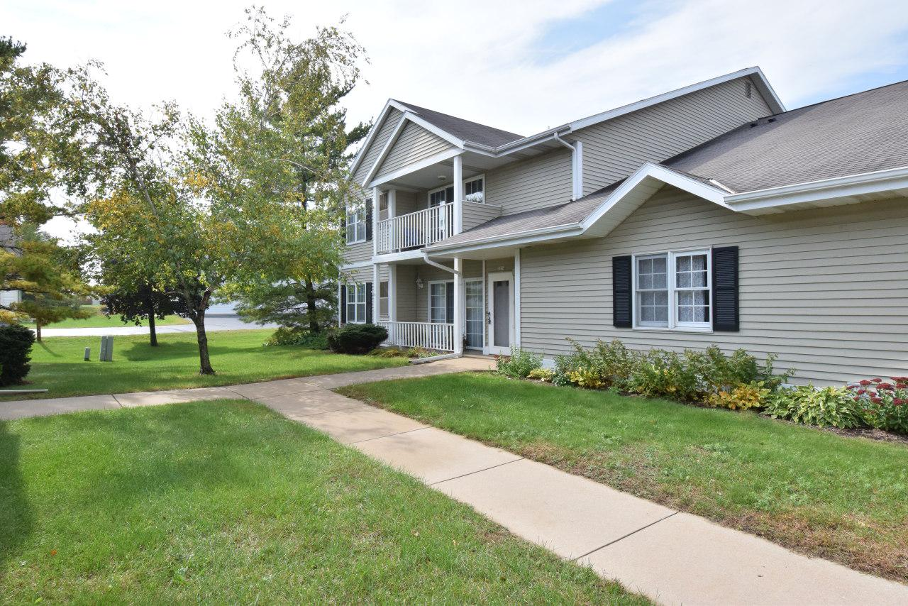 Hard to find great 1st floor condo, just around the corner from grocery stores, shopping and restaurants. Meticulously maintained, spacious open-concept from kitchen to great room. 2 spacious bedrooms and 2 bathrooms make this condo a must have. Convenient 1st floor laundry off back hallway and lots of cabinet space in the kitchen also adds appeal to this very desirable condo complex. Don't miss seeing this condo!