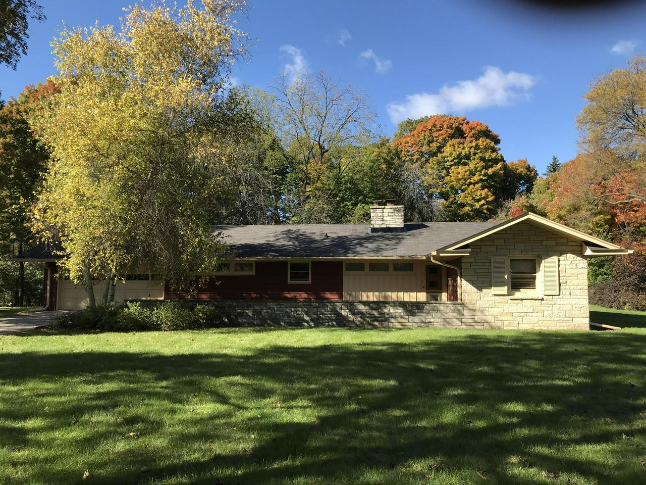 Rare opportunity to own a property in Brookfield, at such a affordable price! Over 1300 sq feet on almost a acre. Living room with natural fireplace and large windows to overlook your treed backyard. Kitchen has a snack bar and all appliances included .Large dining area for holiday gatherings.  Family room offers additional living space that leads to your private patio. First floor laundry with washer and dryer included.  Two generous sized bedrooms. Plenty of closets for your storage needs. Attached two car garage and shed. Make this home yours for the holidays!