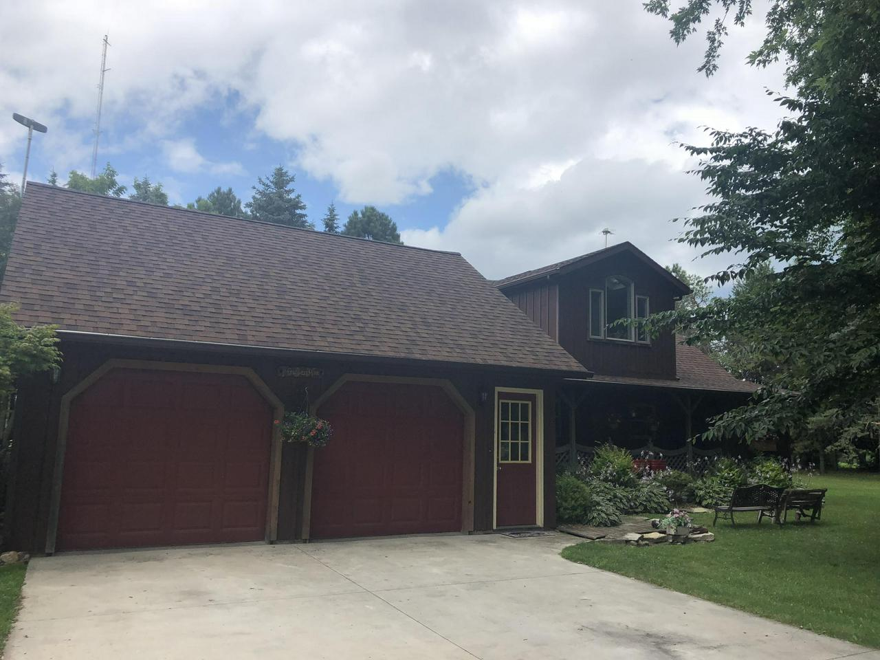 Imagine being able to live minutes from town, while being tucked back in the privacy of your very own 2 acres. This hobby farm is ideal for horses with a barn measuring 9ft, 9ftin length, 19 ft wide and 19 ft. high. The indoor horse arena is a large steel building (40x72) with 2 stalls and a loft above. There are 2 water pumps, one on the inside and one on the outside. On the inside of this 3 bedroom, 2 bath home you will walk into beautiful country charm; hardwoods, exposed chimney, breakfast bar, open staircase and wood beams throughout. A total of 4 garages on this property.  Come and check out this once in a lifetime opportunity before its too late.