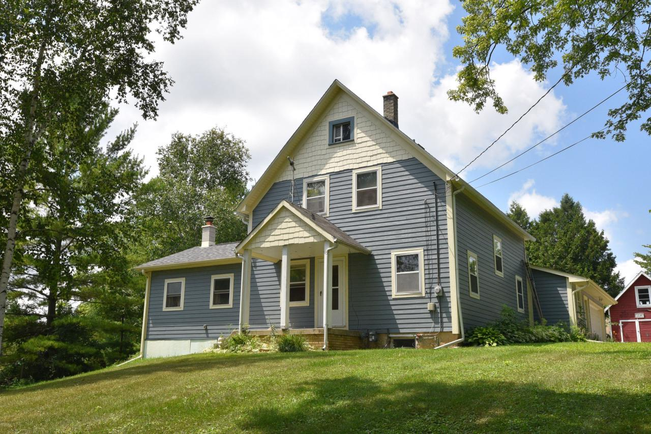 Charm and character abound in this fabulous farmhouse that sits atop one acre in desirable Saukville. Feel like you live in the country while being so close to everything! There was an addition a few years ago with a family room that includes a wood-burning stove and a spacious deck area for more entertaining. The 2.5 attached garage is great for parking your vehicles, while the 2.5 detached garage and shed are perfect for storing all your toys. The lower level below the addition can easily be finished for more living space.
