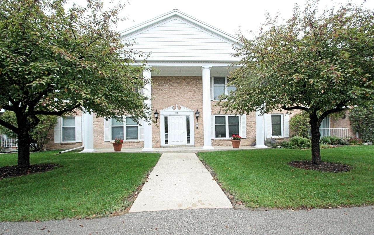 Mequon 2 Bedroom, 2 Bath condo offers affordable, well maintained, QUIET condo lifestyle.  Living Room has a wall of windows with sliding door to covered private balcony overlooking treelined back yard.  Enjoy abundant natural light.  Open dining area and galley style kitchen.  Large master features walk in closet and private bath.  Condo fees include heat & hot water, plus snow/grass and exterior maintenance.  2 heated parking spaces.  Secured entry.  Laundry & elevators on each floor.  Extra storage in lower level.  You will love the location with easy access to freeway, shops and restaurants.