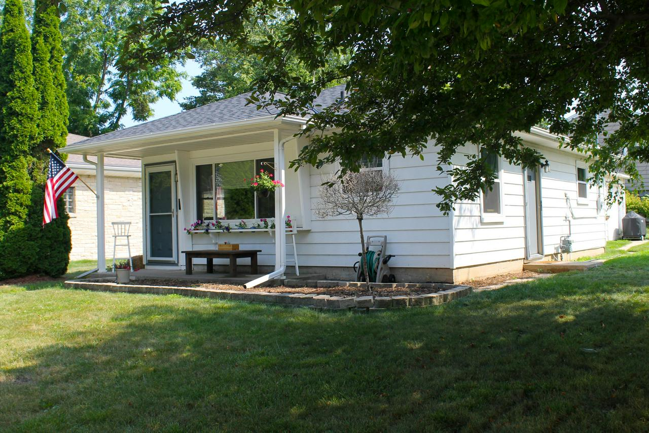 Cozy starter home or low maintenance retirement opportunity in an excellent Port Washington neighborhood. Corner Lot. Ranch 2 bedroom, 1 bath with a 1 car garage. NEW ROOF July 2017 and ALL NEW WINDOWS January 2018. New flooring in family room and hallway as well.  Schanen Park across the street and Dunwiddie Elementary School 1 block away.