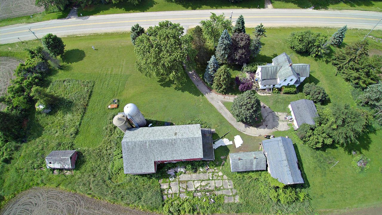 Farm House on 3 acres with 3 bedrooms, 1 bath. Includes barn, outbuildings and 2.5 car garage - plenty of storage space for toys and hobbies.