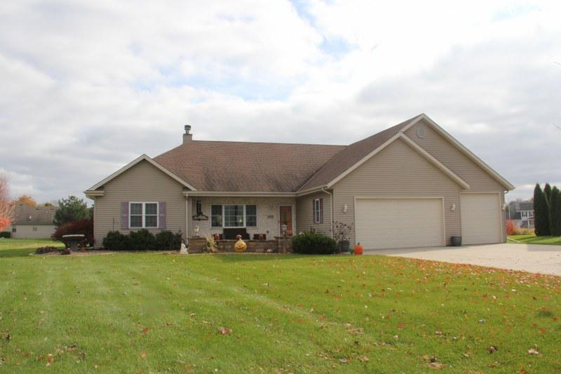 Split BR Ranch w/5.5 car attached garage.  Front & Backyard patios.  Vaulted ceilings in the great room, kitchen and master bedroom.  6 panel doors.  Oak encased windows.  10 ft. ceilings.  1st fl. Laundry.  Great rm. w/corner gas FP & wired for surround sound.  Eat in KIT w/center island, pull outs, pantry, pendant lighting.  Slider door to custom patio w/lighting.  MBR suite boasts walk in closet, double sinks, jet tub/shower.  Finished LL w/large Rec. rm., full bath, wet bar, & perfect spot for 8 ft. pool table.  975 square foot (+/-) attached garage has a 9x9 bay which allows a full size truck plus a 17.5 foot enclosed trailer to pull in and park.