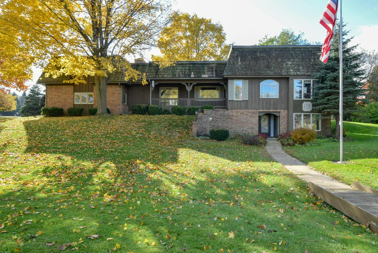 Amazing views of the Aldebaran pond from the porch, living room and kitchen.  Open concept family room, kitchen and living room  Formal dining room off kitchen.  Family room has large stone natural fireplace with woodbox with fill area in garage.  Sliding doors to porch.  3 large bedrooms on main floor.  Garden level of home has 2 more bedrooms, office, craft room  and full bath and storage room.   Stairway to garage from garden level.  Cement pad to enjoy your great yard from.  Pond is stocked with fish or is a great for an afternoon swim.  Special bonus game room above garage will give you an additional 560 sq ft of usable space.  Garage is extra deep.  Access to basement from garage.  Park next to home is part of the Aldebaran property and can be used free of charge.