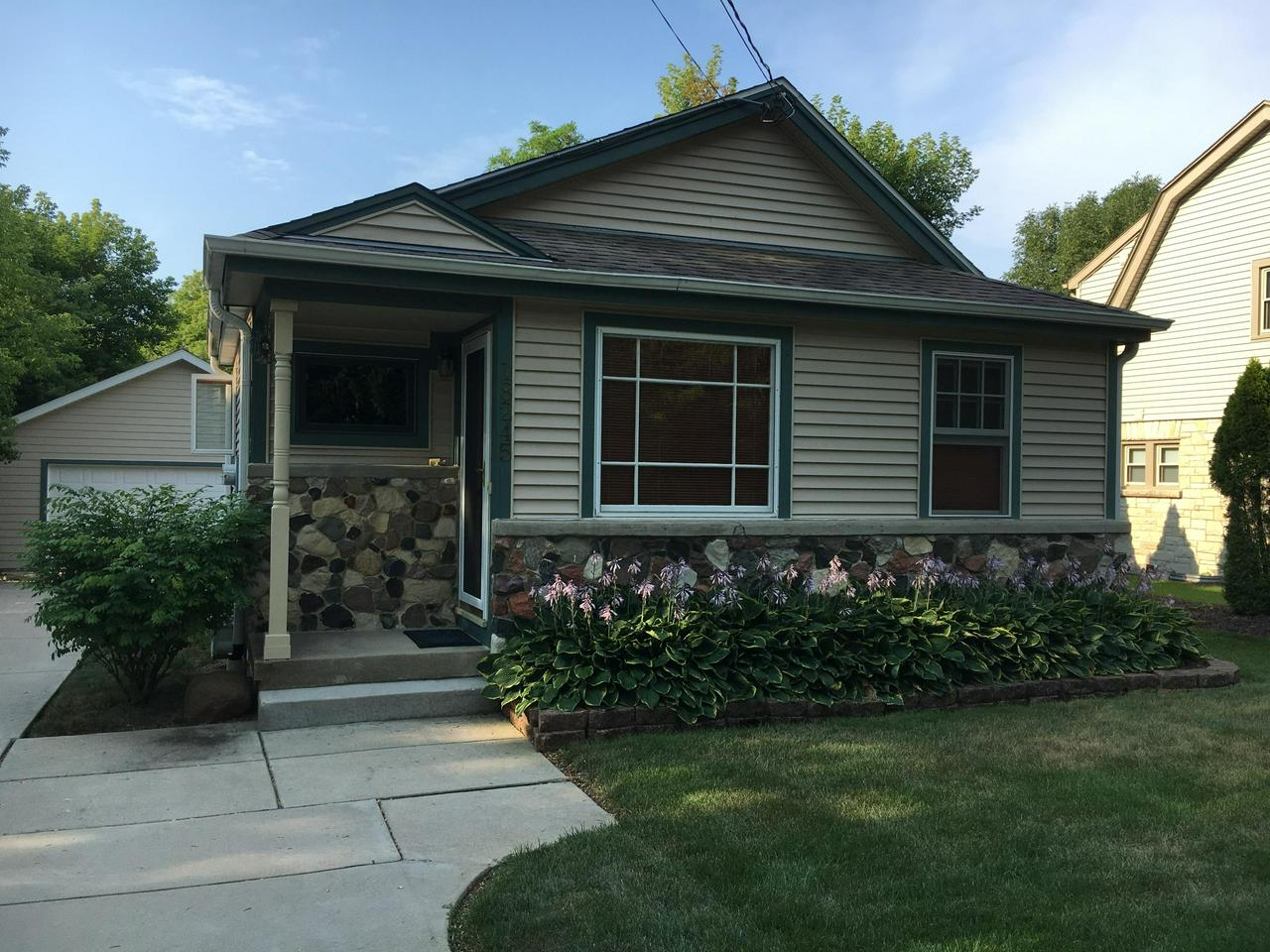 Welcome home to this adorable 2 bedroom, 1 bath in the heart of the Historic Village of Brookfield.  Beautiful Cherry HWF through-out living room and kitchen. Kitchen also boasts raised oak panel cabinets and all appliances included. Attractive bathroom with corian oak vanity. 2 nice size bedrooms with newer carpeting complete the main level. Outside, you will find a Newer('10) Full 2 car garage. Serine and private the backyard is perfect for entertaining or sit and admire the beauty without backyard neighbors. Truly a must see!