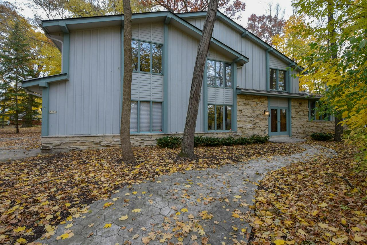 WOW! If you are looking for space to move around in, and a beautiful setting in a quiet neighborhood, yet close to everything...this is it! Come home to this very spacious, open, airy home on a gorgeous lot. The large Great Room features a beautiful stone fireplace that is an amazing focal point, with tons of natural light. You won't have any trouble fitting your furniture in this room.  Patio door that leads to a large deck, and a private back yard. Kitchen features a center island, large pantry, and dinette area. Formal Dining Room, or a great office space. Upstairs are 4 spacious bedrooms. The Master Suite offers tons of space, a dressing area, walk-in closet, master bath, and a huge loft/bonus area. Lower level has a finished Rec. Room, Fresh interior paint and new carpet, a huge bonus