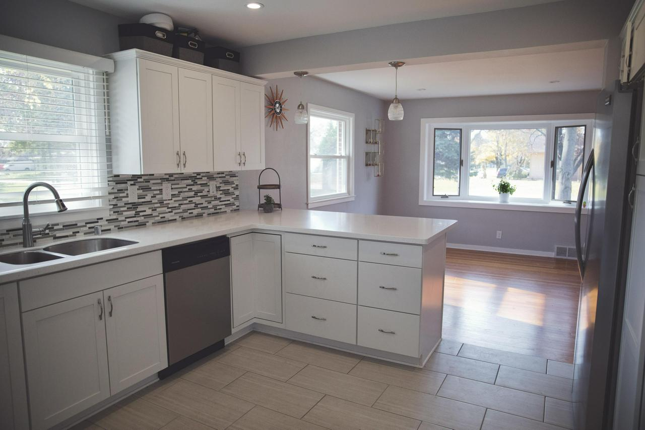 Beautiful brick 3BR 2BA home ready to be occupied. Main level features stainless steel appliances in kitchen with plenty of cabinet space accented with tile back splash and breakfast bar. Living room has lots of natural light from the bay window that is open to the kitchen, great for entertaining. Bright and Sunny Mudroom from garage is anything but ordinary and features tile floor, ample windows and built in storage for coats etc. Lower level is finished off including another full bath.