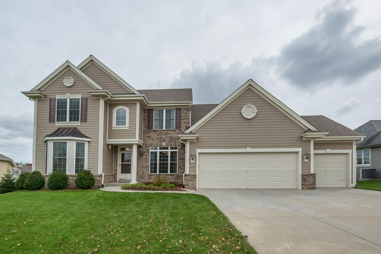 Welcome Home! Close to New Construction 8 year new home.  5 bedroom, 3.5 bath, finished lower level mother in law suite. 1/2 block to city park/playground. 5 minutes from I 94 to Madison, Milwaukee, Chicago. Close to hospital, downtown, shopping, schools and yet in a quiet subdivision.    Highly desired Heritage Hills Subdivision. High end water heater, roof, mechanicals, windows only 8 years old. Walk out lower level to a relaxing patio and spacious back yard. Walk in pantry, First floor laundry. 3 car garage with plenty of space for storage.