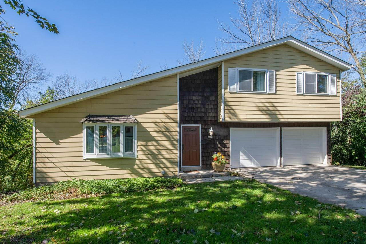 Great location up high on the Grafton Dells, the Milwaukee River is your playground with over 100' of frontage, just south of the dam. Walk to the shops in the downtown area and just a short drive to Costco, Target and Starbucks. There are so many positive aspects of living in this home, A two car attached garage, vaulted ceilings, open floorplan, hardwood floors, 2nd floor loft, walk out lower level rec-room and more! You'll just have to see it to appreciate all in sales to offer. This is a rare opportunity to vacation in your own back yard!