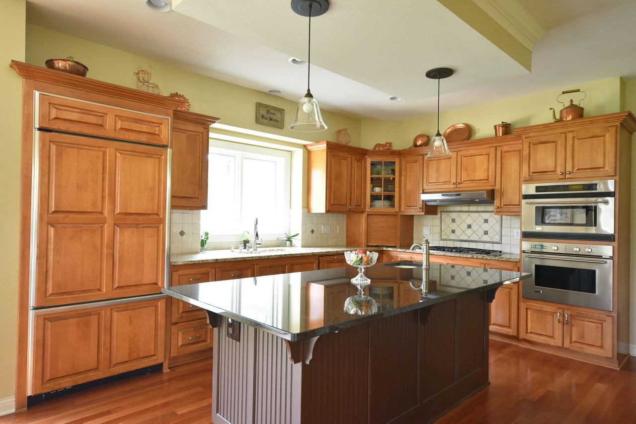 Well Maintained, Custom Built 5 Bedroom on Private Lot in the Heart of Brookfield. Great Room Has Loads of Sunlight Flowing In and a Fireplace. Gourmet Kitchen With 7 ft Island, Custom Cabinets, Pantry and Gorgeous Brazilian Cherry Floors. Main Floor Has Bedroom and Full Bath with Tiled Shower. Master Bedroom Suite with WWC, Walk in Shower, Dual Sinks. All Bedrooms are Generous in Size. Lower Level Family Room with Additional Natural Fireplace W/Gas Starter and Loads of Windows. LL Work Out Area or Game Room and Office or Craft Area. Plus-Central Vac, Sprinkler System and Life Breathing Air Filtration System. Step Outside to Wonderful Brick Paver Patio overlooking a Private, Over Half Acre Yard. Truly A Special Home!