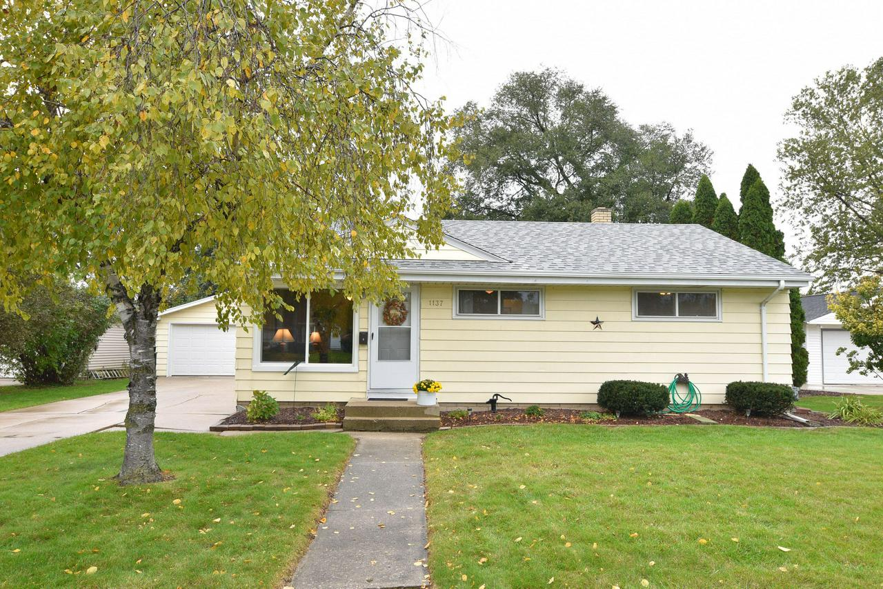Come see this well kept ranch with multiple updates throughout! Gorgeous fenced in backyard with brick patio. Brand new Pella windows, newer roof and furnace. Nice clean and DRY basement full of potential. Located just steps away from parks, Inter-Urban Bike trail and restaurants in Downtown Grafton! One year Home Warranty included for your peace of mind!