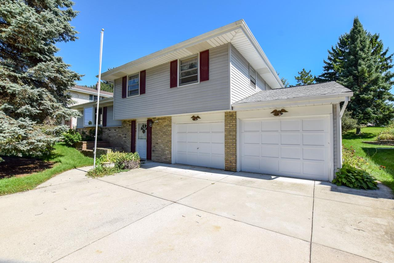 Very motivated sellers! Come see this inviting home located in a desirable Grafton neighborhood. Conveniently located putting you just steps away from coveted Grafton schools & the heart of downtown. This extremely well cared for tri-level, has excellent flow throughout the home providing ample room to sprawl out. LR boasts a floor to ceiling brick FP that connects to DR w/ beautiful French doors leading into a sunny 3 season rm. The home incl (per seller) oak HWF beneath carpet in all BR & LR/DR, updated upstairs BA, energy efficient furnace, A/C, & newer roof w/in  last 5 yrs. There is sufficient storage in partially finished basement & the attached 2 car GA. The lg yard incl a concrete foundation w/ plenty of space for all your tools. Don't wait to see all this home has to offer!