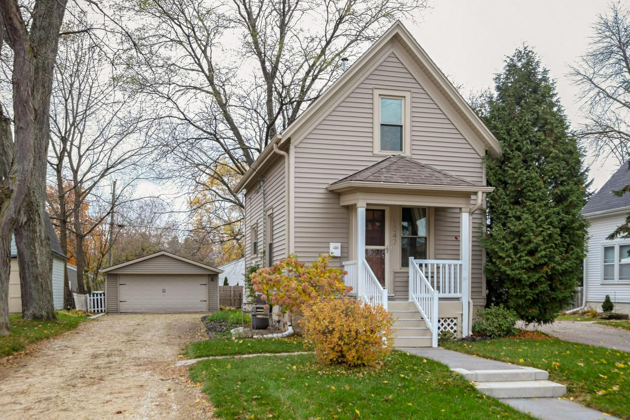 This ADORABLE home welcomes you the moment that you walk up to the inviting composite front porch.  Open the front door and this home exudes a  stunning, welcoming  ''CRATE AND BARREL'' cottage style! A living room and kitchen with an open concept feel with beautiful hardwood floors, newer cabinets in pristine condition.  A bright sunny kitchen perfect to prepare your favorite meal, pour a glass of wine &  share a conversation in the living room with good friends. The deck is perfect for entertaining and grilling as you relax and enjoy a deep fenced yard with 2.5 car garage and deep driveway. The perfect retreat at the end of the day the open staircase leads you to the MSTR BR and 2nd room. IMPECCABLY MAINTAINED HOME Full basement Dry & Clean.  Welcome to Home Sweet Home - Move In & Enjoy!