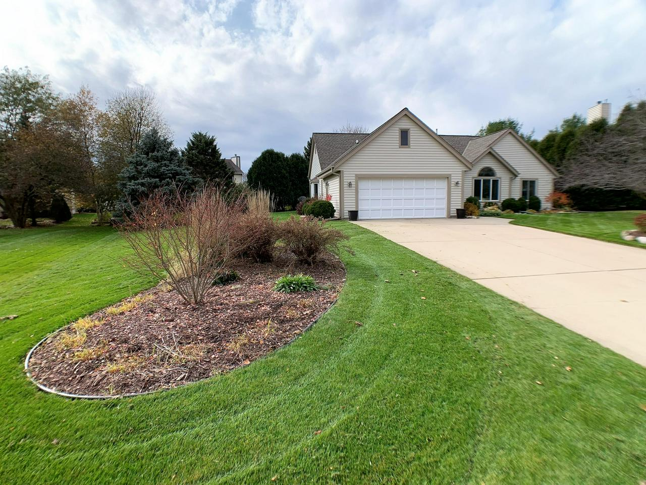 This stunning ranch home is sure to impress the fussiest buyer! This home features a beautifully updated kitchen with newer Stainless Steel appliances and Quartz counters! Open airy great room with vaulted ceiling and a gas fireplace. Spacious Master Suite features large walk in closet and bath with double sinks. Also features a slider to the patio and backyard. Two other bedrooms are large and bright with ample closet space. Main floor laundry with washer and dryer included! Finished lower level offers kitchenette, large gathering space, and a full bath! Ample storage in the unfinished area of the basement or in the newer shed in the backyard! This one will impress you!