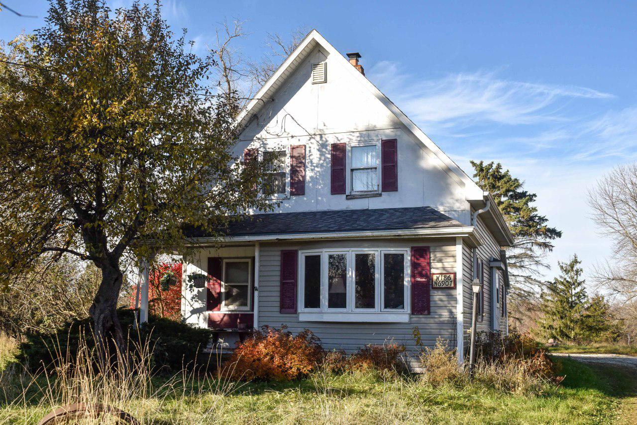 Over 40 acres available in the Lannon/Menomonee falls district. Two-bedroom farmhouse with one full bath. Detached garage shed is currently used for storage. City sewer and water is not available and no future plans as of now per municipalities. Zoned A-1 for both parcels.